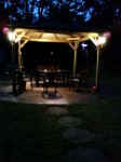 This is the gazebo at night time. Dad installed two lights on the side, and a fan in the middle